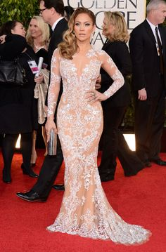 Jennifer Lopez shows off her body in a semi-sheer, intricate white gown.