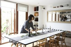 Christine's House: Living Small in London: Remodelista - great idea for book shelves/bench