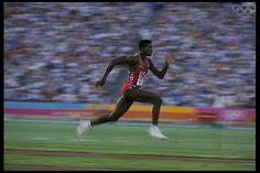 Aug 1984: Carl Lewis of the USA accelerates down the runway of the long jump during the 1984 Summer Olympics at the Los Angeles Memorial Coliseum in Los Angeles, California.