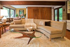 October 2013: A view of the sunken den in 1958 Irwin Stein mid-century modern home near Philadelphia. Furnishings include a vintage mid century sectional sofa covered in Crypton fabric, Adrian Pearsall cocktail table and vintage wool flokati rug. www.athomemodern.com Photo by Laura Kicey.