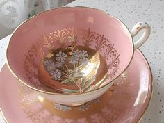 Pink and gold tea cup and saucer.  My favorite,