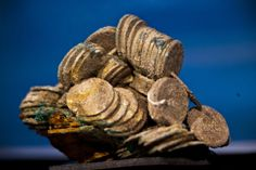 Spain displays treasure from the sunken Nuestra Senora de las Mercedes warship.  A block of encrusted silver coins from the shipwreck of a 1804 galleon, on its first  display to the media at a Ministry building, in Madrid, Friday, Nov. 30, 2012  [Credit: AP/Daniel Ochoa de Olza]