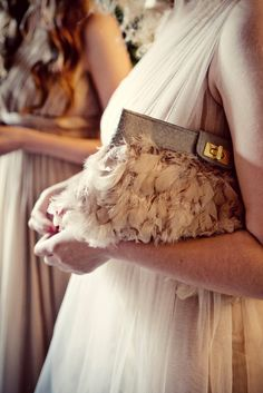 Great feather clutch.