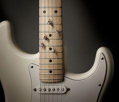escalar guitarra
