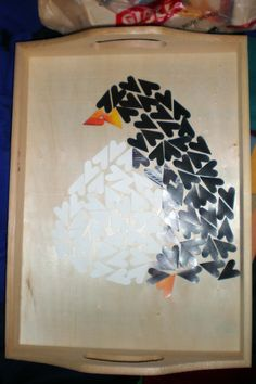 When I first got into decoupage, I bought a craft tray and used heart punches to make a penguin mosaic. Luv the fat penguins!