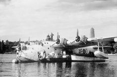 An RAF Short Sunderland moored on the Havel near Berlin unloading salt during the airlift Flying Ship, Flying Boat, Aircraft Images, Ww2 Aircraft, West Berlin, Berlin Wall, Short Sunderland, History Online, American War
