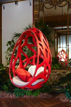 Cocoon by the Campana Brothers for the Objet Nomades collection for Louis Vuitton, perforated pod-like frame with a calfskin exterior and quilted leather interior, plus broadcloth-covered cushions, suspended by a gilded steel and brass hook, POA Louis Vuitton Hanging out - Telegraph