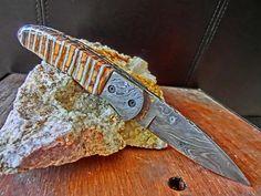 Damascus Folder, Fossil Mammoth Tooth Custom Handmade Pocket Knife, Custom File Work on Blade and Spine. $165.00, via Etsy.