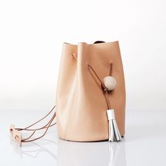 Brand new calf leather bucket bag with wood ball Brand new never used calf leather bucket bag. Very unique and minimal design from a local independent designer. Super chic style. 100% calf leather. Top quality.  LOVE IT. Original over $350 MiNiMal Bags Crossbody Bags