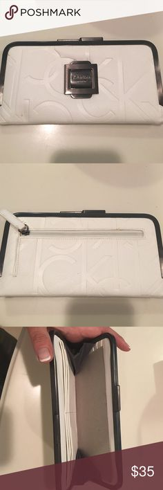 Calvin Klein wallet New   White. Inside has credit card compartment.  Outside zipper for coins Calvin Klein Bags Wallets