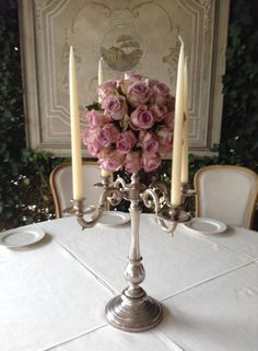 elegant silver candelabra centerpiece with sphere of lilac roses