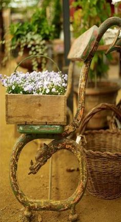 .love the rustic bench, old box of flowers and basket.....