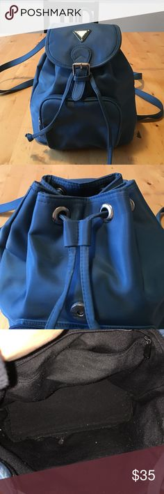 "Guess Backpack Blue Nylon Guess Backpack. No scratches perfect condition.  Inside is lined in black and has a zipper compartment. Outside zipper compartment and bucket/flap closure. The arm straps are adjustable. 8x10"". No trades/no paypal. 10% bundle discount. Guess Bags Backpacks"
