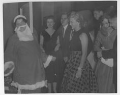 Students at Holiday party. (Caption on back: Christmas Dance 1955 Santa Claus Harris Spencer)