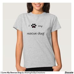 "I Love My Rescue Dog Shirt Love animals? Did you save your furry friend from a shelter? Let everyone know with this t-shirt that says ""I love my rescue dog!"" The word love is represented by a paw print with 2 hearts inside. The back of this shirt features the same paw print with adopt, foster and rescue written around it.  Shirt color can be changed by clicking the ""customize it"" button.  Animal rescue."