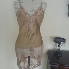 Beautiful crochet top Gold color. Below your waist length. You can dress it up or down. With jeans Hale Bob Tops