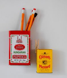 How cute!  Simply glue magets to the back of little spice tins for organizers to stick on the fridge!