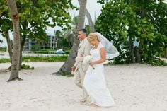 Beach elopement at Smathers Beach, Key West, Florida. Officiant, bouquet, photography, and logistical arrangements provided by Small Miami Weddings. www.smallmiamiweddings.com