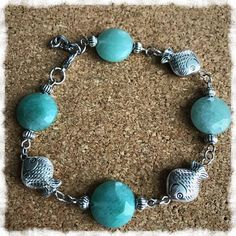 "Jade Color Stones Bracelet Regular price $10.00 This charming 8-10"" handmade bracelet has Jade color stones with small silver beads and some fish embellishments."