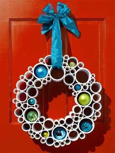 Lovely looking Christmas wreath with PVC pipes and Christmas balls. Christmas balls aren't only hung on trees as you can also hang them in Christmas wreaths now in well cut out PVC pipes.