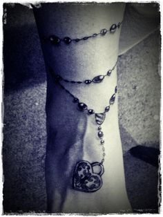 barna's new tattoo!!  Who will have the key to my heart? rosary.anklet tattoo.