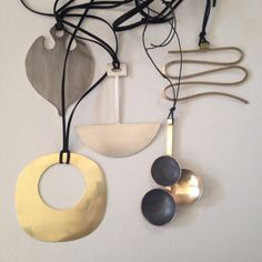 Heidi Abrahamson Large pendants, pewter & brass.