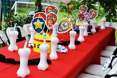 Here's a paw-some idea for your next Paw Patrol party: place a dog bone straw cup at each setting. These adorable party cups include removable tops and sipping straws, making it easy and fun for kids, and even better for the post-party clean-up.