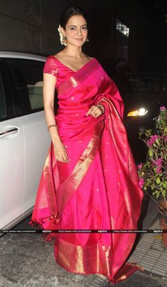 The wedding season ain't over yet. Actors Kangana Ranaut, Sonam Kapoor, Dia Mirza and Madhuri Dixit put their best foot forward at a wedding reception in Mumbai on February 27. Take a look Actress Kangana Ranaut looked graceful in a rani pink Madhurya sari, paired with jhumkis and gajra.