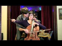 Amazing Cello Duet with Four Hands, One Cello...the way she looks at him throughout the song.....love it.