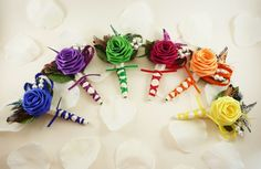 Rainbow boutinniers for the groomsmen. -LP <3