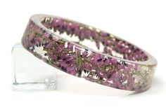 Real Dried Flower and Resin Bangle-Pink Flower Bracelet- Resin Jewelry-Flower Jewelry Pink and Green. via Etsy.