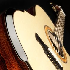 Handcrafted, bespoke acoustic guitars for those who wish to experience the exhilaration of playing a truly responsive instrument fashioned to the highest standard
