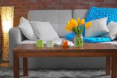 Freshen up your interior for spring with some simple-to-execute, spring redecorating techniques using art, color, and fabric.