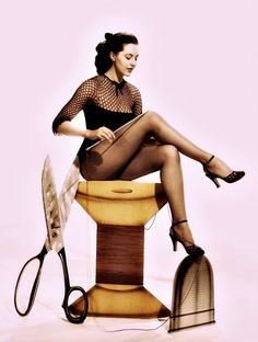 Cyd Charisse with sewing props