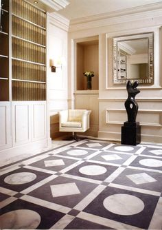 Bespoke Roman-inspired geometric floor made from English Cumbrian slate and Italian Calcatta marble - http://lapicida.com Surfacing Magazine February 2013