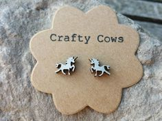Silver Unicorn stud earrings - horse jewellery Hand painted silver leaf wood - sterling silver posts available by TheCraftyCowShed on Etsy https://www.etsy.com/listing/237256512/silver-unicorn-stud-earrings-horse