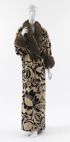 Coat, 1911  Paul Poiret (French, 1879–1944)  Textile design by Raoul Dufy (French, 1877–1953)  Ivory and navy block printed velvet with brown fur trim and gold metallic mesh-covered silk closures