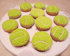 Tennis Ball Cupcakes...super simple to make, even for beginners. Just pipe the seams with a small round tip and mix together yellow and green icing together for the fuzz. Create the texture with a small open star tip and that's it!