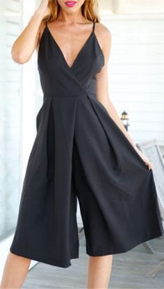 In a surplice fit, this casual jumpsuit features comfy fabric fallen from adjustable camis detailing into a plunging collarline and an elastic waist for an easy fit.
