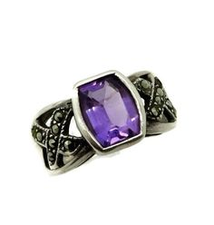 Vintage Lab Created Amethyst and Marcasite Sterling Silver Wide Band Ring. The Ring is Size 7.5 The Amethyst is approx 2.5 Ct The Band tapers from 9 mm to 3 mm in back  Hallmark: 925  It is in good condition  A gift ring box is included   See more Vintage Rings here: http://etsy.me/1O1EODC  ➜Want to save for later? Click on the Add to button to create a personalized list. ➜Ready to buy? Click the big green Add to Cart button.  ➜Combined Shipping: Buy 2 or more items, pay shipping for one…