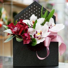 The orchids and alstroemelias sit tight together in this enveloped box arrangement. Facebook Sign Up, Floral Arrangements, Orchids, Envelope, Gift Wrapping, Box, Floral Swags, Paper Wrapping, Flower Arrangements