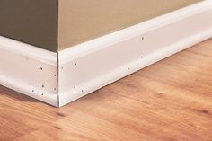 Definitely read this post before you start patching and painting baseboards! This is the easiest method that I have seen! Click through to the post to see how! Bathroom Baseboard, Wood Baseboard, Baseboard Styles, Dark Baseboards, Painting Baseboards, Painting Trim, Best Bathroom Paint Colors, Dark Wood Trim, Trim Paint Color
