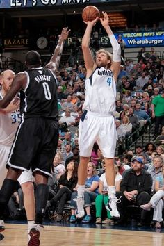 Dirk Nowitzki #41 of the Dallas Mavericks shoots against Andray Blatche #0 of the Brooklyn Nets on March 20, 2013 at the American Airlines Center in Dallas