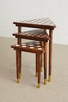 Gorgeous nesting tables with inlaid mother of pearl.