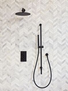 Marble bathrooms 370702613081111836 - Our Midtown thermostatic concealed shower looks striking against our East Haven chevron marble tiles, in this monochromatic bathroom. Modern Marble Bathroom, Marble Countertops Bathroom, Chevron Bathroom, Marble Bathroom Accessories, Chevron Tile, Bathroom Floor Tiles, Marble Tiles, Tiling, Bathroom Design Inspiration