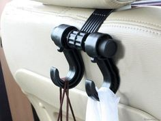 This traveling pro hooks behind your car seat and creates hanging space for handbags, shopping bags, backpacks See On Tv, Cool Gadgets, Storage Spaces, Car Seats, Hanger, Vehicles, Stuff To Buy, Random, Clothes Hanger