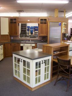 A kitchen island is a gathering place that adds storage and much needed preperation space