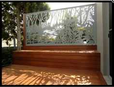 A small area deck  with bench seat and storage where you also want privacy with this artistic screen. #deck #screen