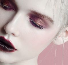 duochrome red and gold eyeshadow with dark vampy lips and pale skin