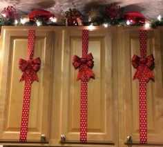 "christmas decor diy inspiration -- ""wrap"" your cabinets.  these materials would be inexpensive to get from the dollar store but have a GREAT impact"